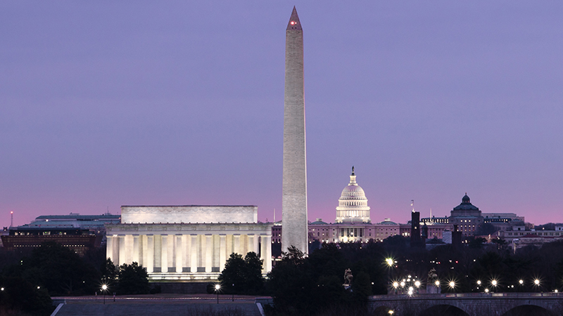 Photo of the Washington, D.C. skyline at dawn, with views of the Lincoln Memorial, Washington monument and Capitol building.